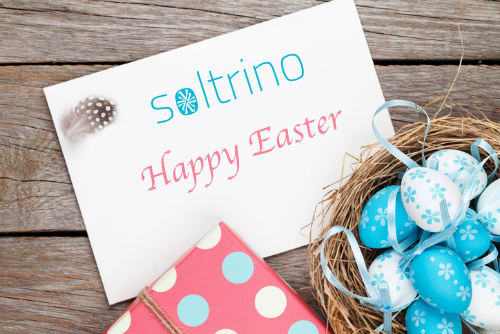 Easter greeting card with blue and white eggs